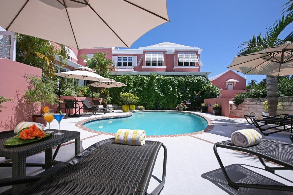 The swimming pool at or near Royal Palms Hotel