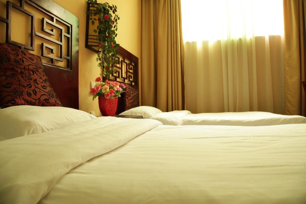 Postel nebo postele na pokoji v ubytování Kungfu Hostel Songshan Shaolin Temple