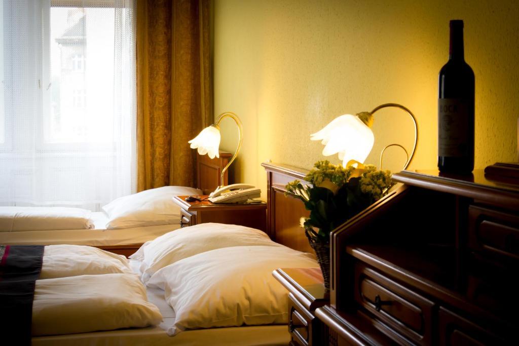 Een bed of bedden in een kamer bij City Hotel Unio