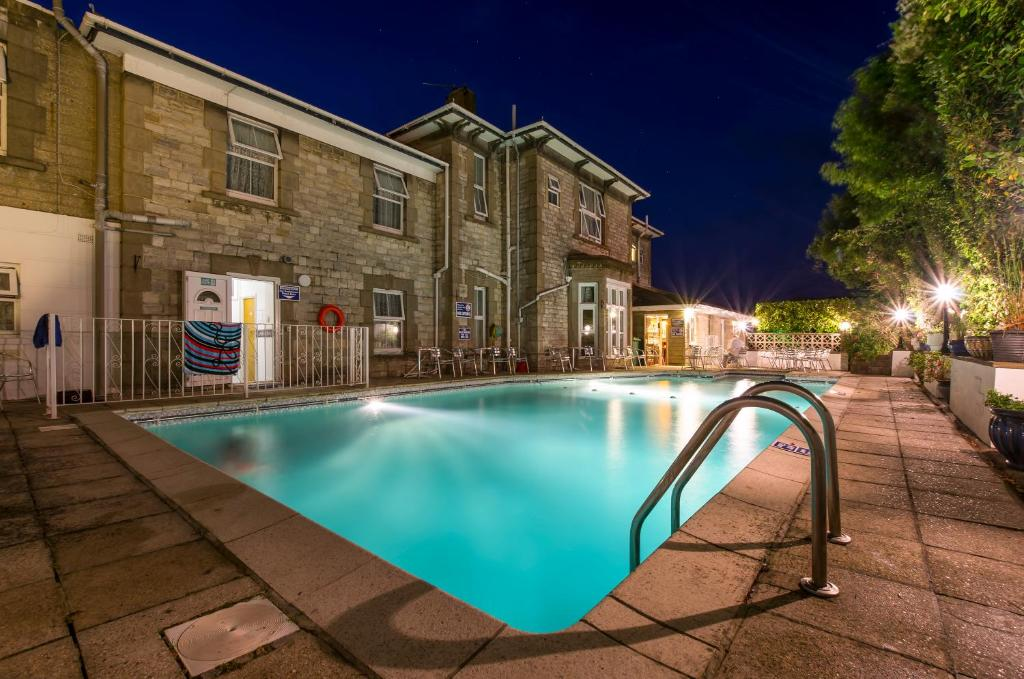 The swimming pool at or near Queensmead Hotel