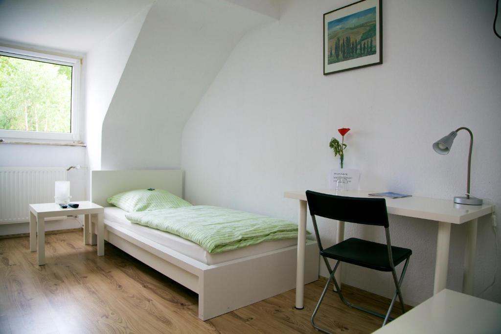 Ein Bett oder Betten in einem Zimmer der Unterkunft Hotel Hoffmann