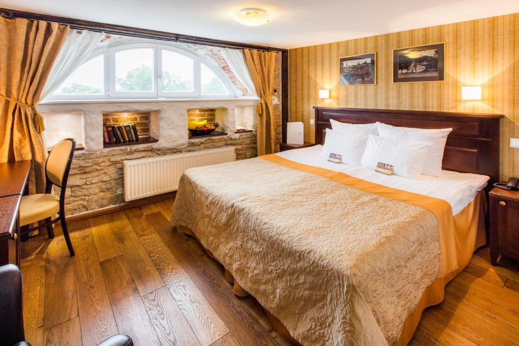 A bed or beds in a room at The von Stackelberg Hotel Tallinn