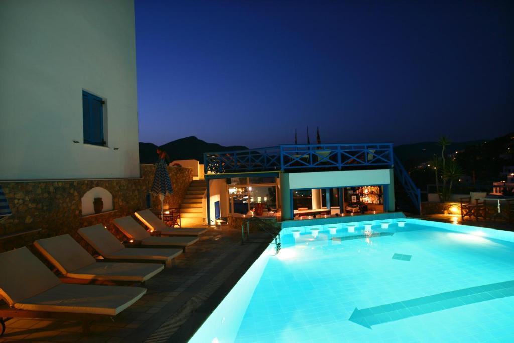 The swimming pool at or near Poseidon Hotel