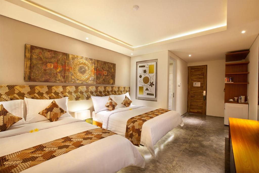 Un ou plusieurs lits dans un hébergement de l'établissement JOCS Boutique Hotel
