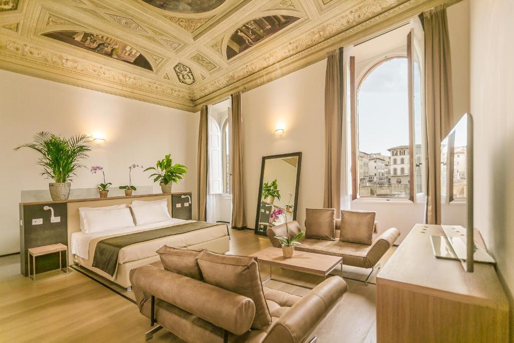 A seating area at Palazzo Alfieri Residenza D'Epoca - Alfieri Collezione