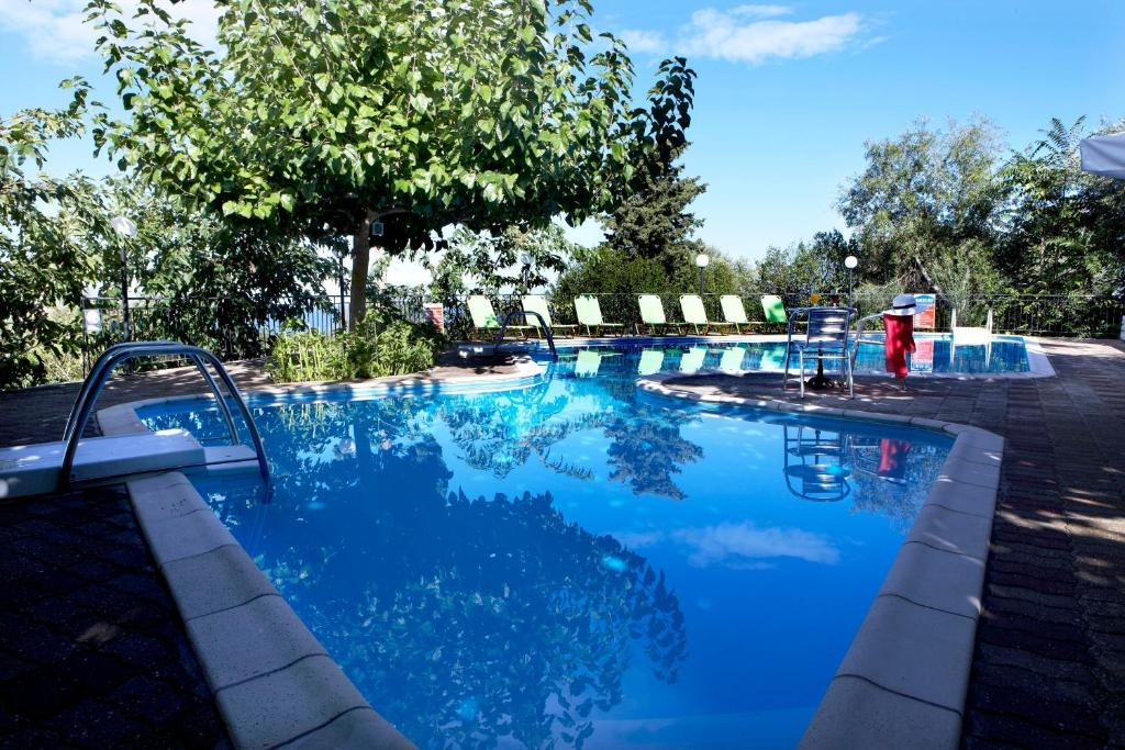 The swimming pool at or near Dafnoudi Hotel Apartments