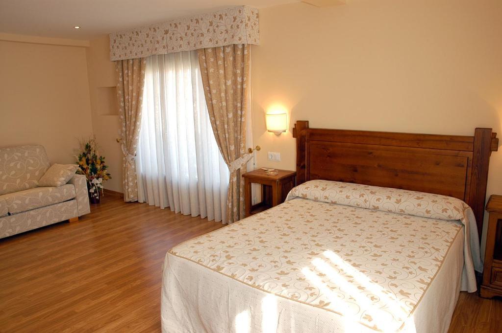 Cama o camas de una habitación en Aparthotel Tres Caminos