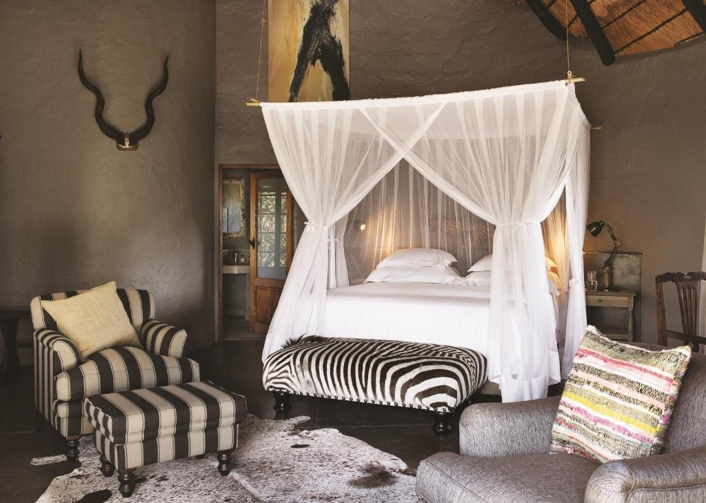 A bed or beds in a room at Motswari Private Game Reserve