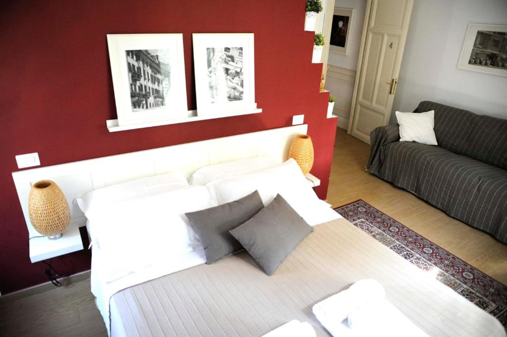 A bed or beds in a room at Pigneto Luxury Rooms
