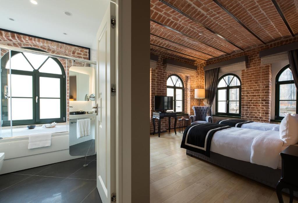 Кровать или кровати в номере Régie Ottoman Istanbul - Special Category