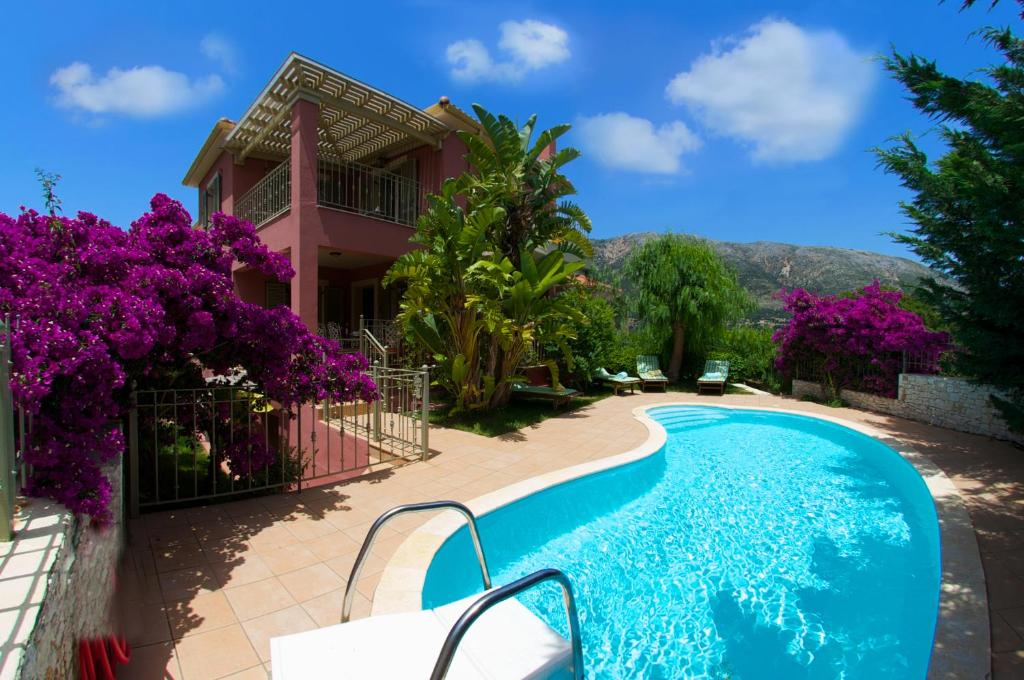 The swimming pool at or near Stamoulis Villas