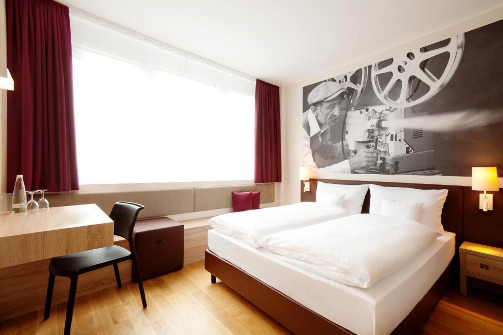 Кровать или кровати в номере Vienna House Easy München