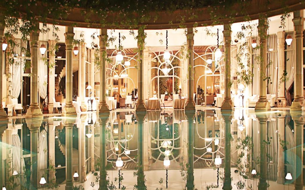 The swimming pool at or near Le Palais Rhoul and Spa