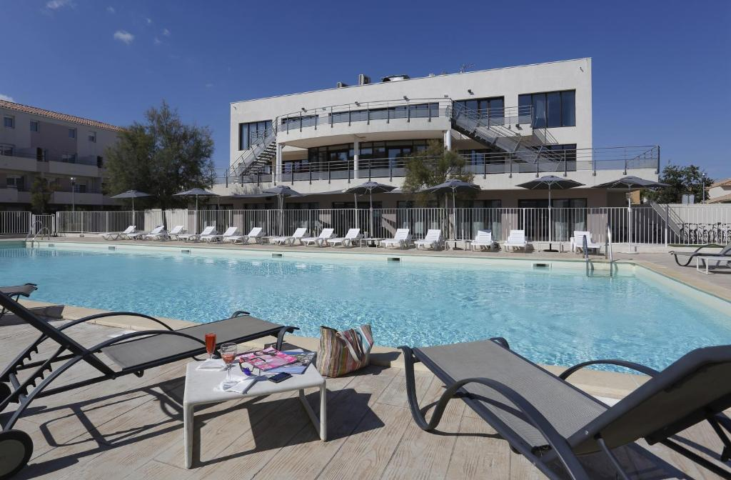 The swimming pool at or near Vacancéole - Résidence Cap Camargue
