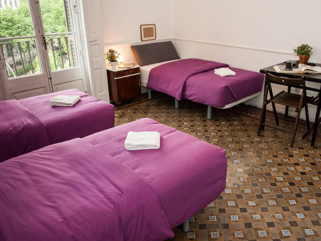 Llit o llits en una habitació de El Puchi Barcelona