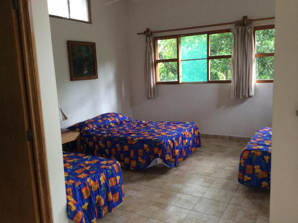 A bed or beds in a room at Aventurec