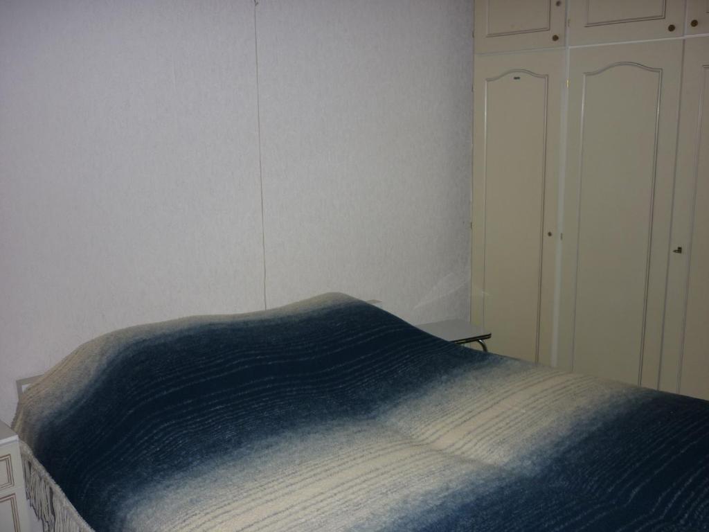 Een bed of bedden in een kamer bij Apartment Noordzee 7