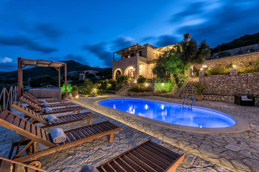 The swimming pool at or near Villa Armos