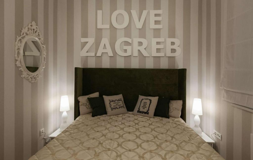 A bed or beds in a room at Apartment I Love Zagreb