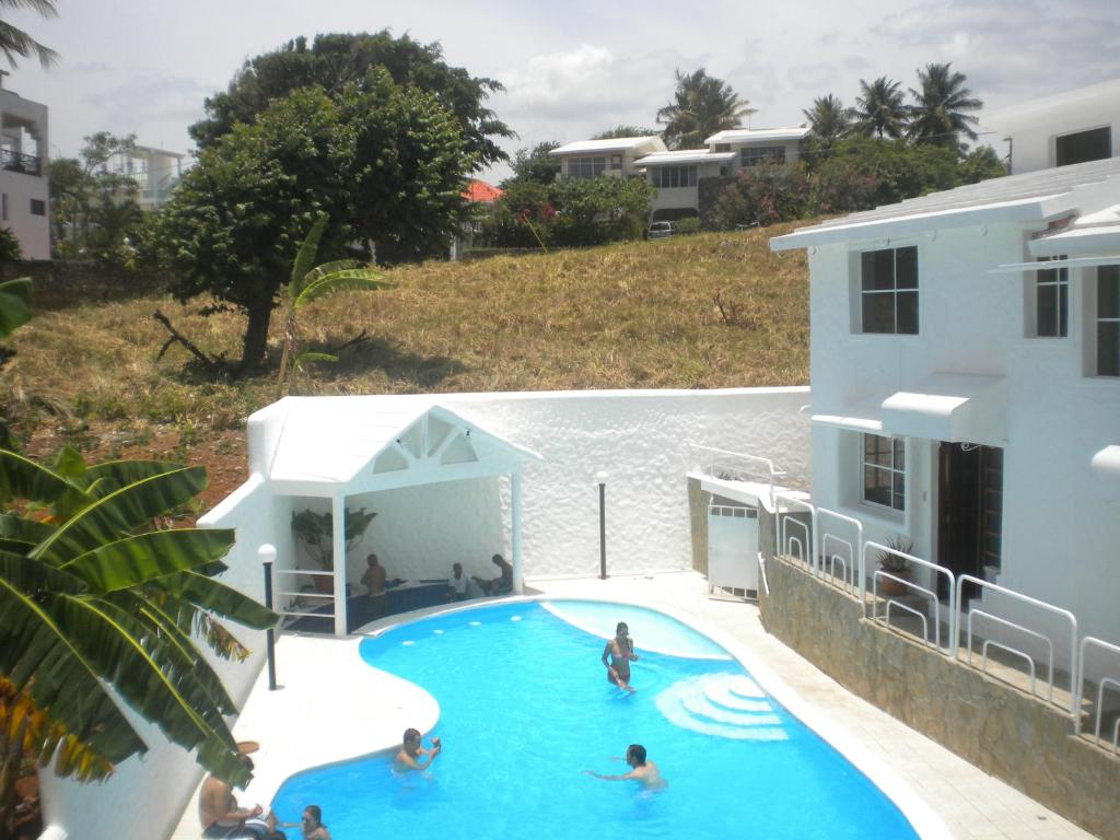 A view of the pool at Caribbean Sun Residential or nearby