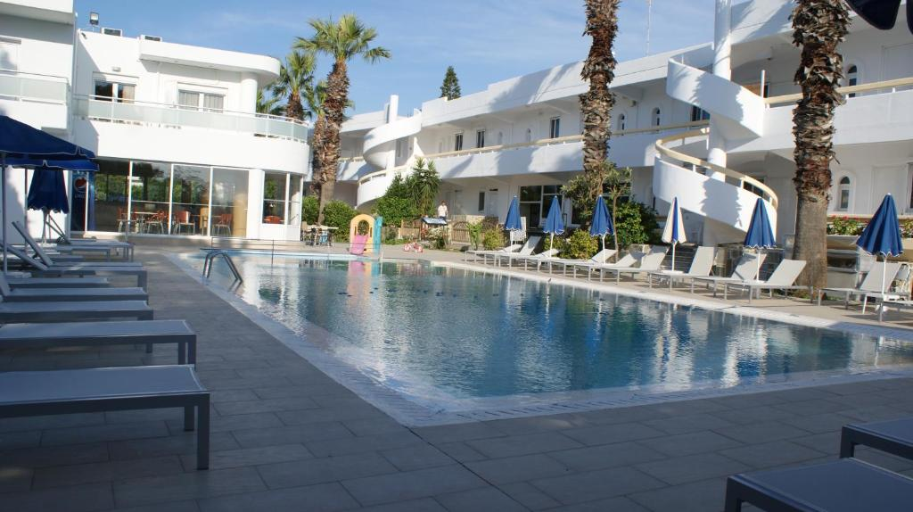 The swimming pool at or near Paleos Hotel Apartments