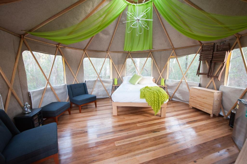 A bed or beds in a room at Talo Retreat