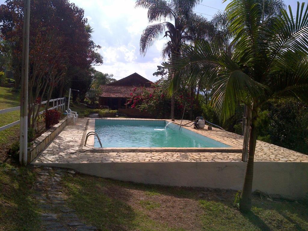 The swimming pool at or near Pousada Céu de Luz