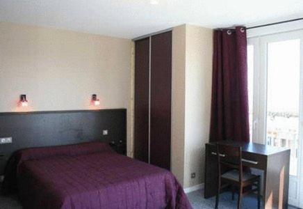Un ou plusieurs lits dans un hébergement de l'établissement Hotel Le Richelieu