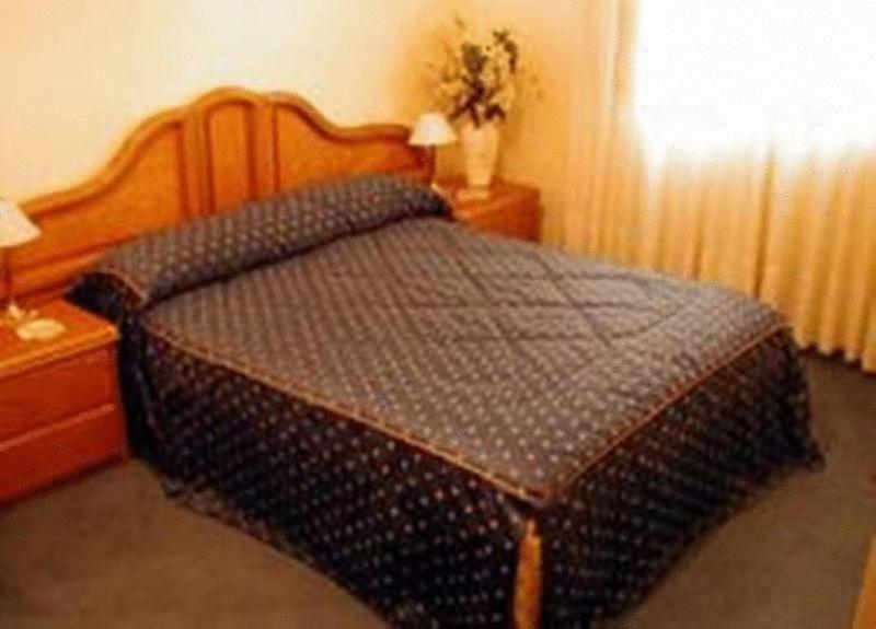 Una cama o camas en una habitación de Goya Hotel