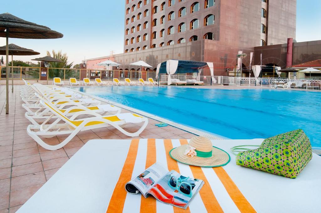 The swimming pool at or near Leonardo Hotel Negev