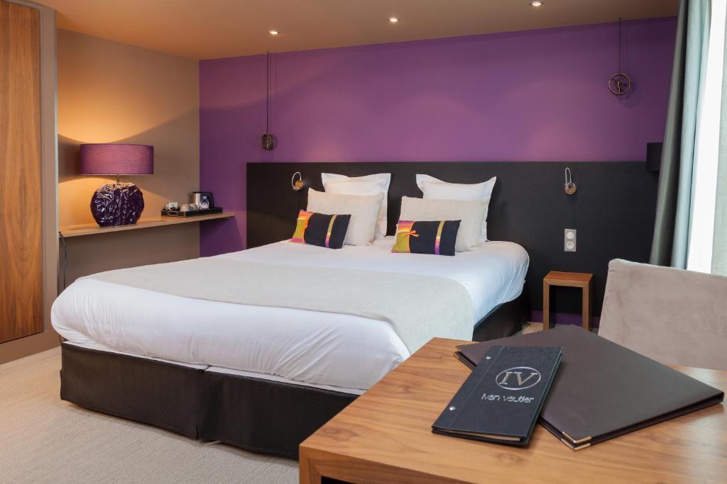 Un ou plusieurs lits dans un hébergement de l'établissement Hotel Restaurant Spa Ivan Vautier