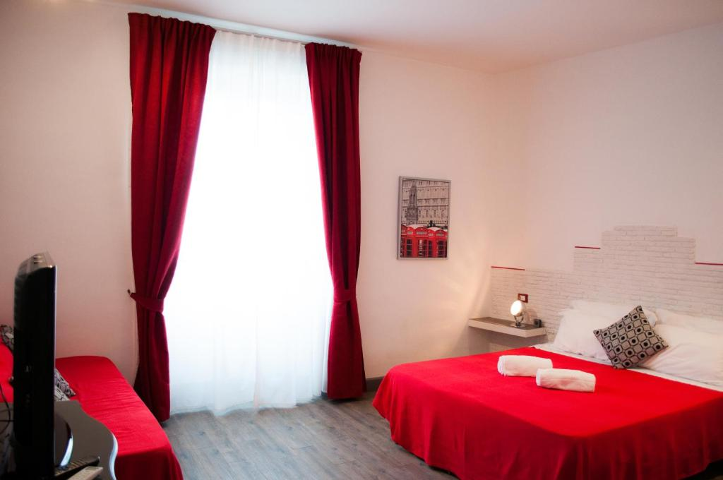 A bed or beds in a room at Relais Cola Di Rienzo