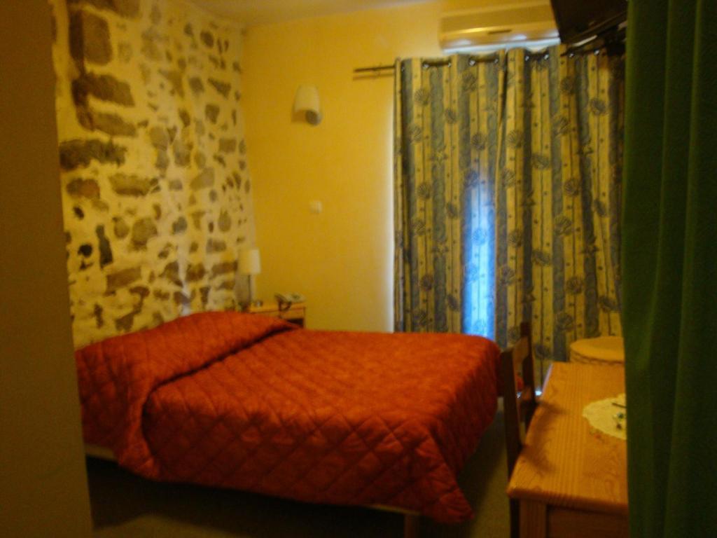 Un ou plusieurs lits dans un hébergement de l'établissement Le Bilboquet