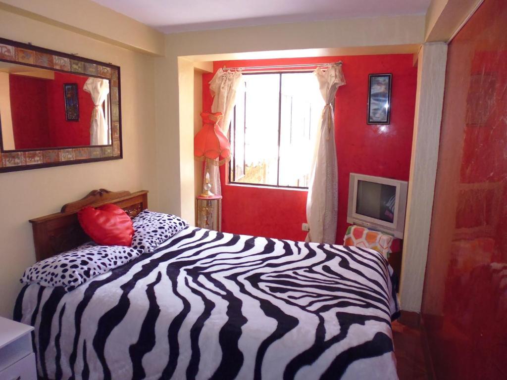 Voodi või voodid majutusasutuse Hospedaje Pumacurco Betty toas