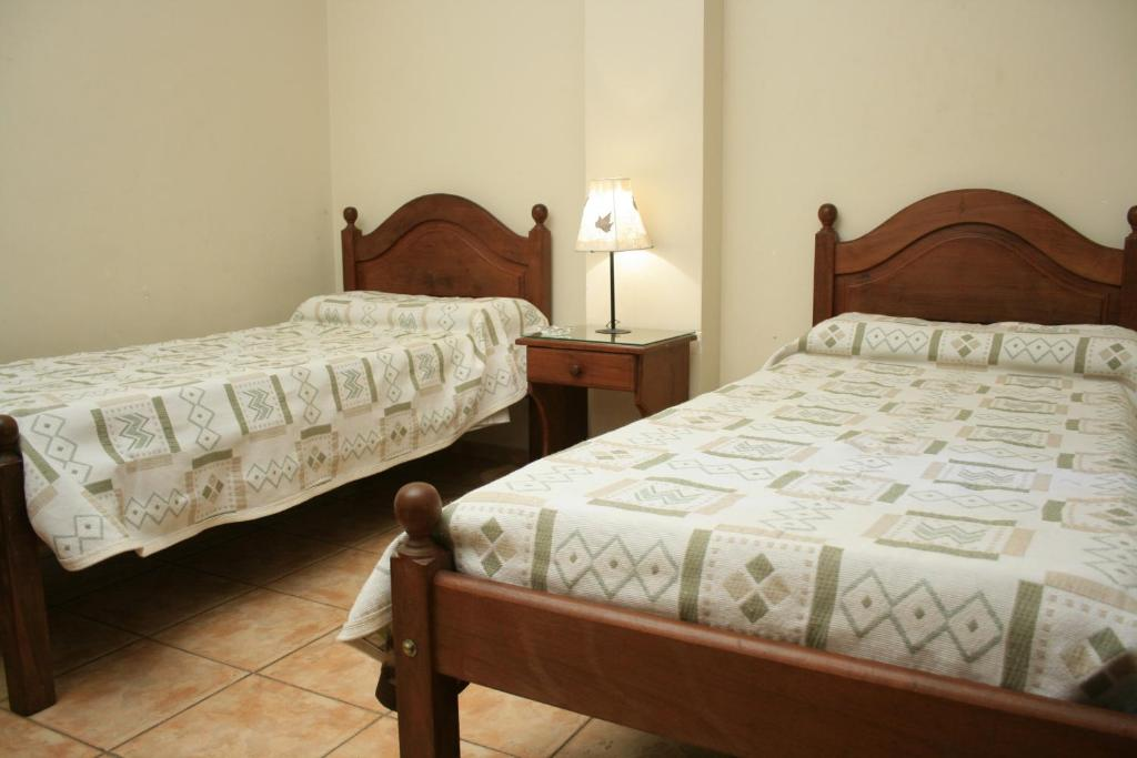 A bed or beds in a room at Colon Hotel y Apart