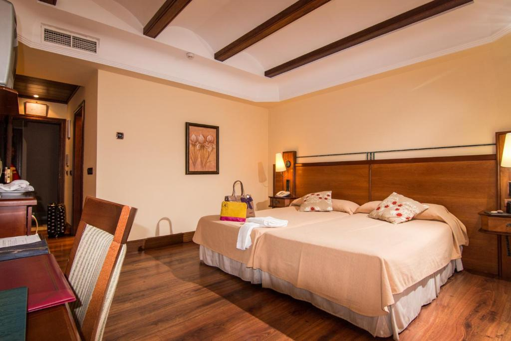 A bed or beds in a room at Abades Guadix