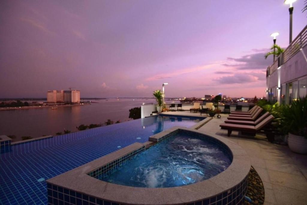 The swimming pool at or near Harmony Phnom Penh Hotel