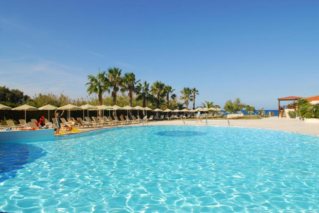 The swimming pool at or near Minos Mare Hotel