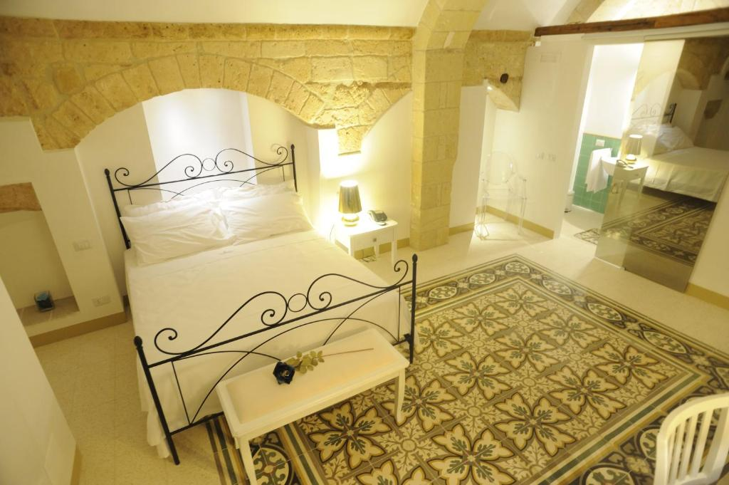 A bed or beds in a room at Il Nido dei Falchi B&B