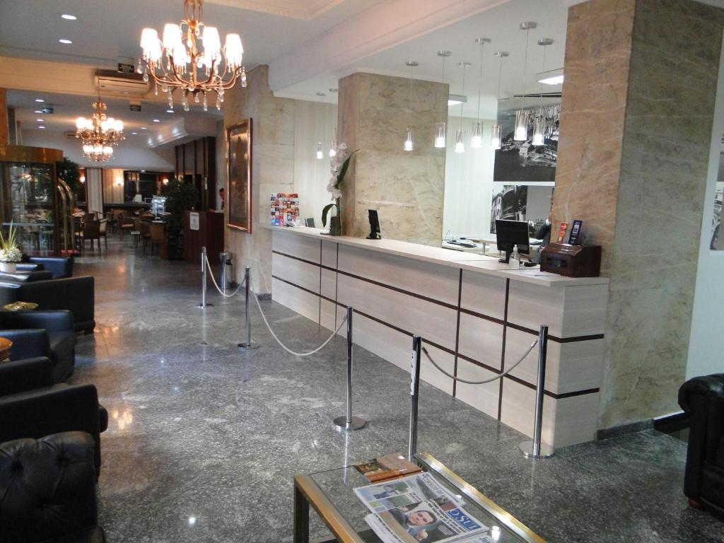 The lobby or reception area at City Hotel Porto Alegre