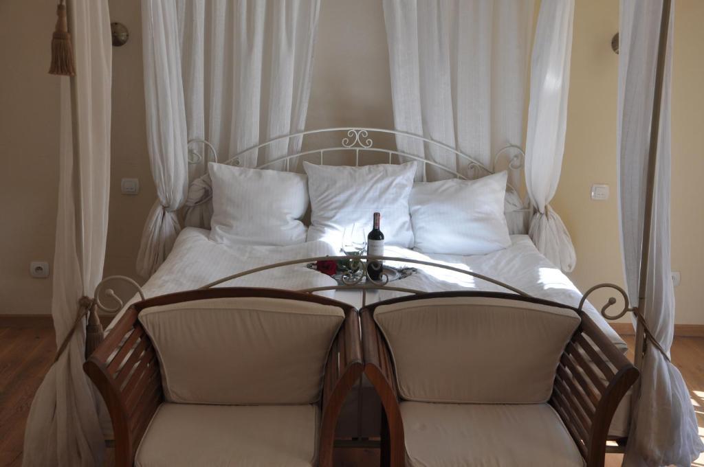 Łóżko lub łóżka w pokoju w obiekcie Hotel Porto-Fino