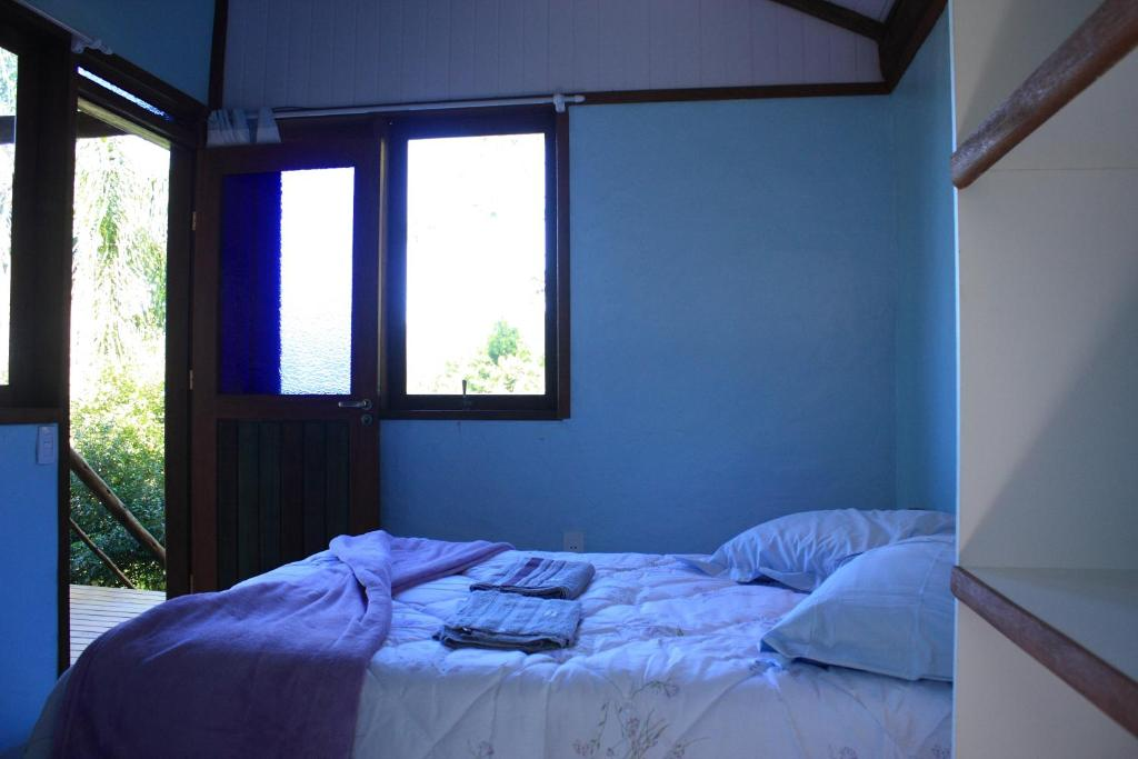 A bed or beds in a room at Aruna Eco Spa