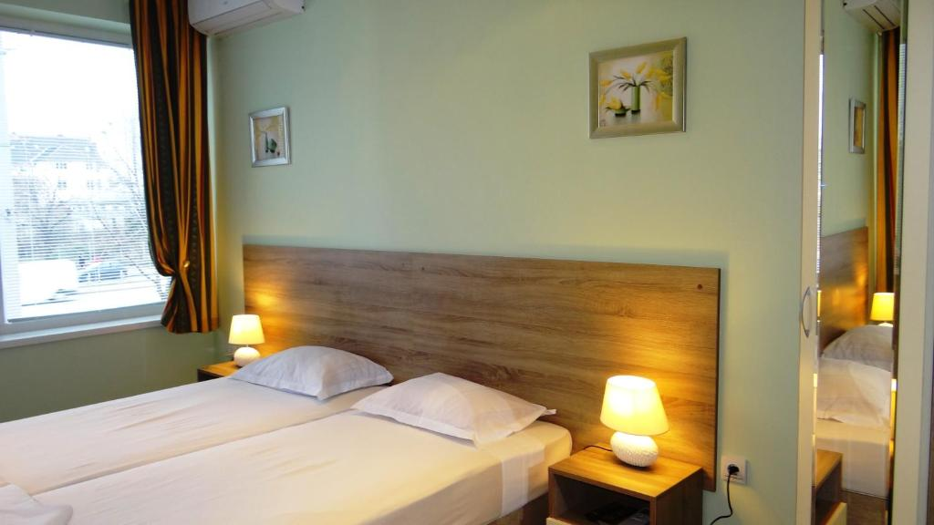 A bed or beds in a room at Guest Rooms Kom