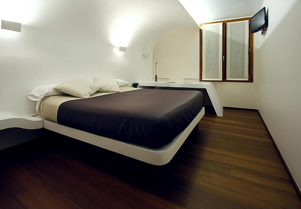 Ein Bett oder Betten in einem Zimmer der Unterkunft Pensión Iturriza