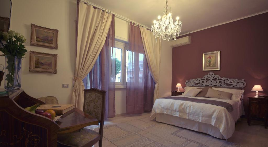 A bed or beds in a room at Gregory Place Fine Vatican Suites