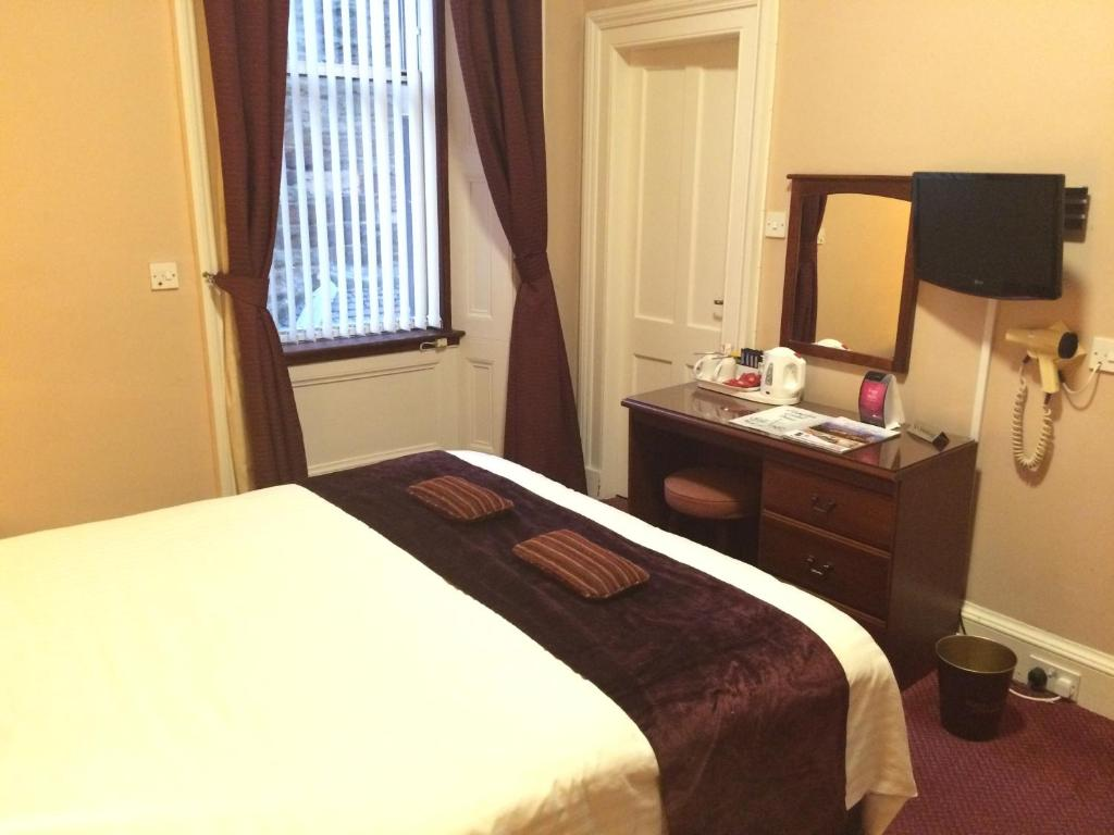 A bed or beds in a room at Hampton Hotel by Greene King Inns