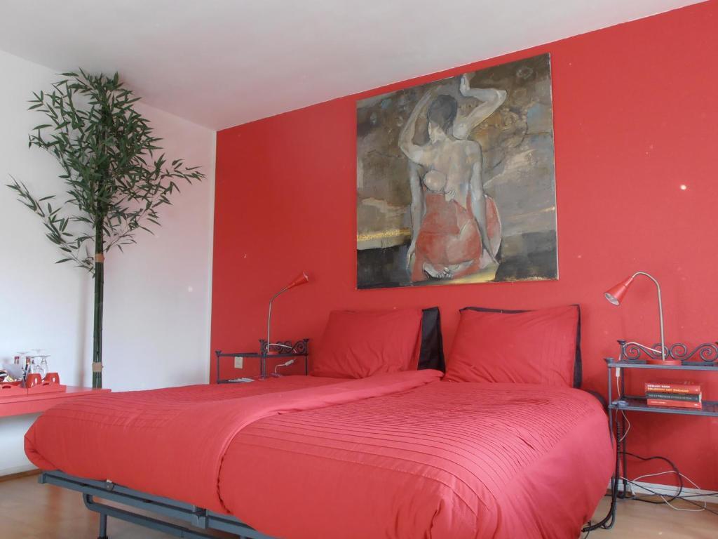 Un ou plusieurs lits dans un hébergement de l'établissement B&B Jossefin Tuinen