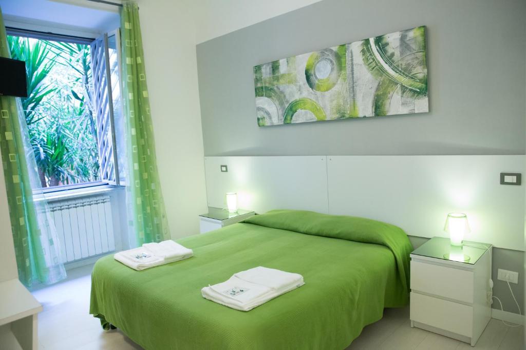 Un ou plusieurs lits dans un hébergement de l'établissement B&B Piumith