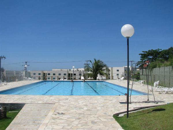 The swimming pool at or near Luxuoso Apartamento em Cabo Frio