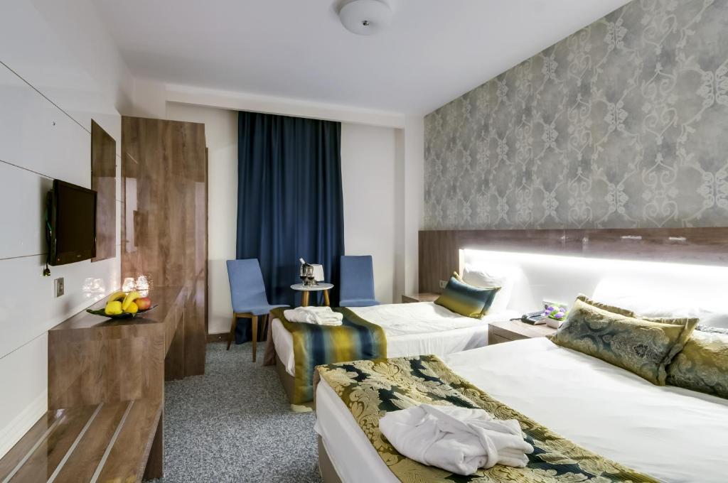 سرير أو أسرّة في غرفة في فندق بارك يالجين